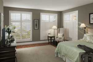 pvc shutters in a green bedroom