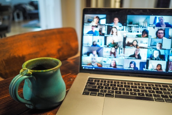 Work colleagues on Zoom call on laptop in a home office