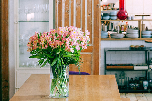 Spring flower arrangement on kitchen table