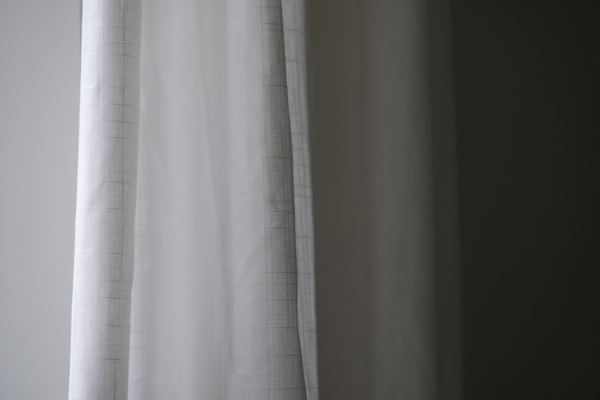 Closed white blackout curtains